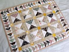 mini quilt - so pretty, love the triangles and the flying goose border!