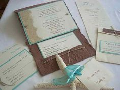 unique beach wedding invites (I like the sand on the side)
