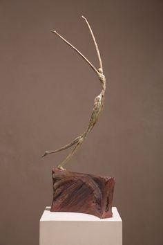 "Leap of Faith by Alex Watts. 32"" X 16"" X 7"". Bronze."
