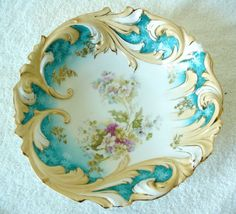 R S Prussia vintage bowl with hand painted flowers and gold accents