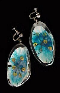 Lilly Ascher, USA: earrings  sea shells, feathers, copper, brass, wire,  other materials  encased in acrylics    1946 or 1947