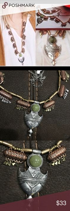 New Free People bo ho green stone necklace Nwt Free People bo  ho  type necklace . Copper , silver  colors. Silver medallion with green stone .  Price crossed out to prevent store return.  Very cool necklace. Free People Jewelry Necklaces