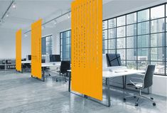 Facade hanging screen made from 100% wool felt. The solid bottom panel section gives additional privacy for desk areas, while the more open design of the top half helps retain the open plan feel of the space.