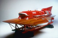 1953 Ferrari Hydroplane  I simply HAD to post this pic! This is just too awesome to pass up. Check out the mahogany on the upper deck of this beauty!