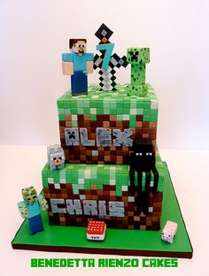 Minecraft Birthday Cake - The Minecraft cake that I made for my boys' birthday party this past Sunday. Their favorite characters were included as requested, Steve, Creeper, Zombie Steve, an Enderman and some mob animals. Thank you Bobie from OUT-OF-THE-BOX Cake Design for letting me copy her sword topper design and all her helpful advice. Also to Renee from The Cake Fairy for her tips too!
