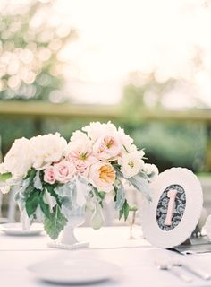 Peach and Pink Wedding Centerpiece With Dusty Miller