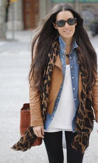 Layers. Tan jacket over chambray shirt, with leopard scarf.