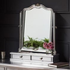 The Silver Chic Dressing Table Mirror has a French style design. Hand crafted to the highest quality this bench will add countless amounts of elegance to your bedroom. Part of the Hudson Chic range this piece is made in the UK with quality materials. Dressing Table Mirror Design, Shabby Chic Dressing Table, Dressing Mirror, Shabby Chic Style, Parisian Chic, Silver Furniture, French Furniture, Luxury Furniture, French Mirror