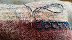 This is part of a tutorial on working the chain stitch found among the Viking Oseberg ship burial embroidery.