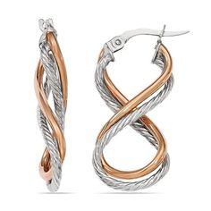 Two-tone Gold Twisted Rope Infinity Hoop Earrings. These infinity hoop earrings feature a highly fashionable twisted rope design in 14k white gold with a second polished 14k rose gold hoop.  Pair with our twisted rope engagement rings or bands for a complete set.  Handmade in Italy. www.brilliance.com