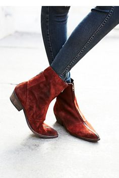 Caldera Ankle Boot   These zipper accented leather ankle boots are in a luxe suede with a pointy toe.  Exposed zip in back for an easy on/off.  Stacked heel.