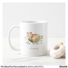 Woodland inspired mug features a sweet watercolor fox nestled in a bed of green eucalyptus leaves and foliage. Personalize with a name, initial or monogram beneath in classic grey lettering. Christmas Mugs, Christmas Card Holders, Stainless Steel Coffee Mugs, Baby Shower Fun, Fun Baby, Glass Water Bottle, Personalized Coffee Mugs, Woodland Creatures, Watercolor Animals