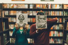Tivoli and David pose during their engagement session inside a book store in Long Island, NY. Captured by NYC wedding photographer Ben Lau.
