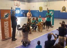 Miami Dolphins Visit Lester H. White To Talk About Pet Responsibility
