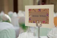 "Homemade touches included tables named after the couple's favourite cities (""we made sure at least one person on each table had been there"")."