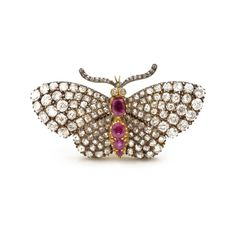 EN TREMBLANT DIAMOND & RUBY BUTTERFLY BROOCH A en tremblant brooch in the form of a butterfly, the wings set throughout with diamonds and the abdomen set with rubies. Mounted in silver and 18ct yellow gold. English, circa 1850.