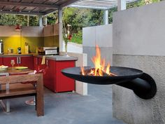 The Sunfocus outdoor fireplace / BBQ combination certainly takes grilling to an entirely new level. What a sleek, smart addition to any outdoor kitchen. Fully functional as an outdoor...