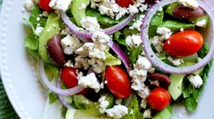 Ingredients 1/4 cup extra-virgin olive oil 2 tablespoons red wine vinegar 1/2 teaspoon salt 1/4 teaspoon pepper 1 large cucumber 1/2 cup kalamata olives 4 large tomatoes, sliced 1 large onion, sliced 4 cups romaine lettuce or other green lettuce of choice 4 ounces feta cheese, diced or crumbled Zest of 1 lemon 1 teaspoon …