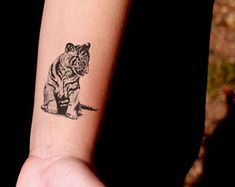 Amazing Tiger Tattoo On Wrist