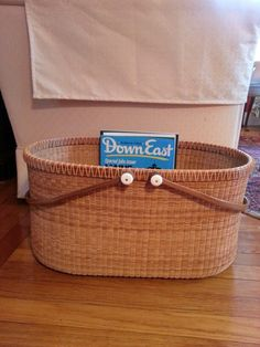 Perfect for organizing magazines...Nantucket style picnic basket by Helen Lee.