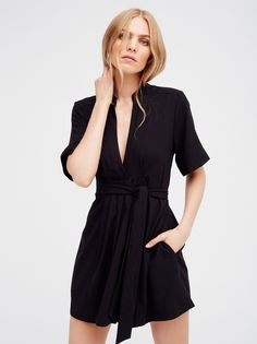 Watch And Learn Mini Dress | Super comfortable and lightweight mini dress featuring a deep V-neckline and rolled sleeve cuffs for an effortless feel. Tie at the waist creates a perfectly wrapped look.