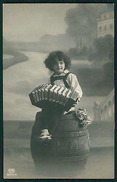 Little girl playing concertina accordion Music original old 1910s photo postcard