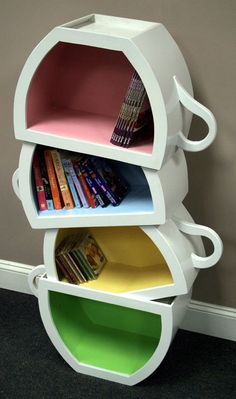 This stacked teacup bookcase would be wonderful for holding cook books in a kitchen.
