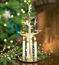 spinning-angel-chimes-candle-holders-with-four-white-candles. One of my fav Christmas traditions. Christmas Angels, All Things Christmas, White Christmas, Vintage Christmas, Christmas Time, Christmas Ornaments, Christmas Poinsettia, German Christmas, Christmas Candle