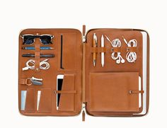 Gorgeous... Holds laptop, tablet, phone, cords, keys, chargers, glasses, earphones etc etc. Perfect leather color