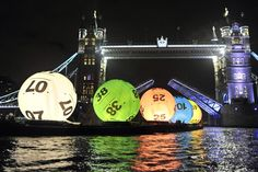 Giant Lotto balls float down Thames River in London to launch the revamped National Lottery