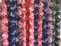 A fun selection of ruffle scarves in a range of colours.