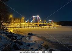 Stock Photo: Suspension bridge and frozen lake in the winter scene in Finland -