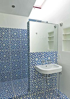 I hate the tile.. but what I like is the idea of the sink being turned. I wonder if our plumbing could be adjusted. I think it would create better flow while still providing privacy for the one in the shower.