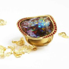 Katherine Jetter Marquis Boulder opal ring in gold with pavé rubies. http://www.thejewelleryeditor.com/jewellery/opal-jewellery-australian-black-white-opals/?gclid=CN_andCs5MkCFQymaQodEPgKCg