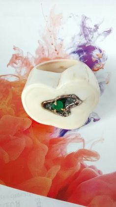 Ivory silver and emerald.