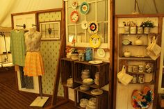 #charlottetaylor #porteliot #anthropologie Display in the Anthropologie tent showing our CHARLOTTE by CHARLOTTE TAYLOR collection, and the Ant print wallpaper.