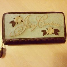 "Juicy Couture blue & brown wallet 100% Authentic Juicy Couture wallet with gold hardware.  *Blue has normal wear from inside of purse. Its not ""dirty"" because it was spot cleaned regularly. The wear comes from coming in contact with other items in my purse.   *Brown outside in great condition with no scratches or damage.  *Inside clean with no stains or damage.  *Side coin pocket has wear from coins.  Apx measurements: 7"" length x 4"" depth Juicy Couture Bags Wallets"