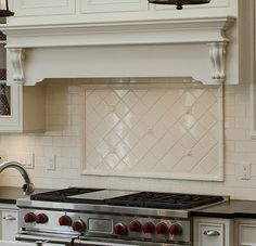 cream subway tile backsplash | the fireplace surround is done in 2