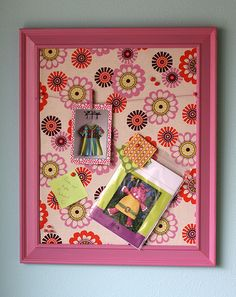 Tracy used a 16 x 20 store bought frame. Remove the glass and cardboard. The fabric she selected is Sugar Pop Mod Flowers in Cream Pink by Liz Scott.  Tra