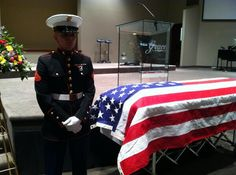 A Marine stands over the casket of his wife and fellow Marine, for the last hour of her calling hours. They met as recruits and married not long after. She gave birth to a healthy baby girl before losing her battle with bone cancer at 20 years old. This is love and one of the saddest stories I've ever heard.