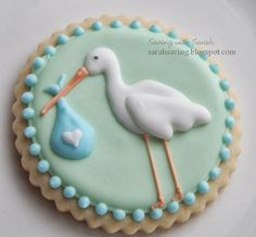 [Stork Stop baby shower ideas] Oh....my....goodness. These cookies are so perfect with the invitations I designed, like they are meant to be. And I bet they taste as good as they look. (cookies via Saving with Sarah)