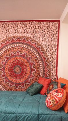 Tapestry and decor pillows. Hate the style, but I love the idea of a tapestry