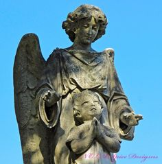 Angel With Praying Child New Orleans Cemetery