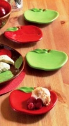"""Apple-Shaped Appetizer Plates (Set of 4) by TAG. $29.99. 6.125""""l x 5.875""""w; dishwasher safe; set includes 2 green and 2 red plates; hand painted. earthenware. 651246  Features: -Material: Earthenware.-Hand painted.-Two each red and green apple-shaped plates.-Dishwasher safe."""