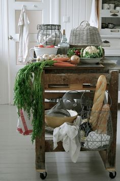 Add a wire basket to the end of an island for ...fresh produce, breads or folded towels... nice vintage look