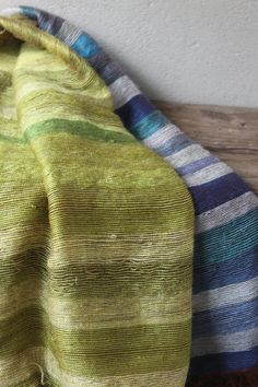 Striped mohair knee blankets in blues and greens