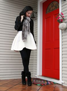 white flouncy skirt, black tights and booties. Winter by ishandchi, via Flickr