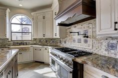 17408 Champions Lakeway. Kitchen has gorgeous honed & leathered granite on the counters. Island in a different granite. Thermador range has a steam oven & warming drawer. Custom tiles in the back splash. Bernstein Realty, Houston Real Estate.