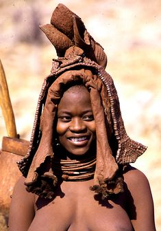 Africa | A Young Himba woman, shows off the headdress she wore on the day of her wedding.  Namibia | ©Andreas E.S.