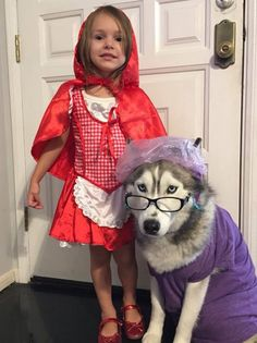 Adorable Halloween costume. A little girl as red riding hood and her dog as the old woman.